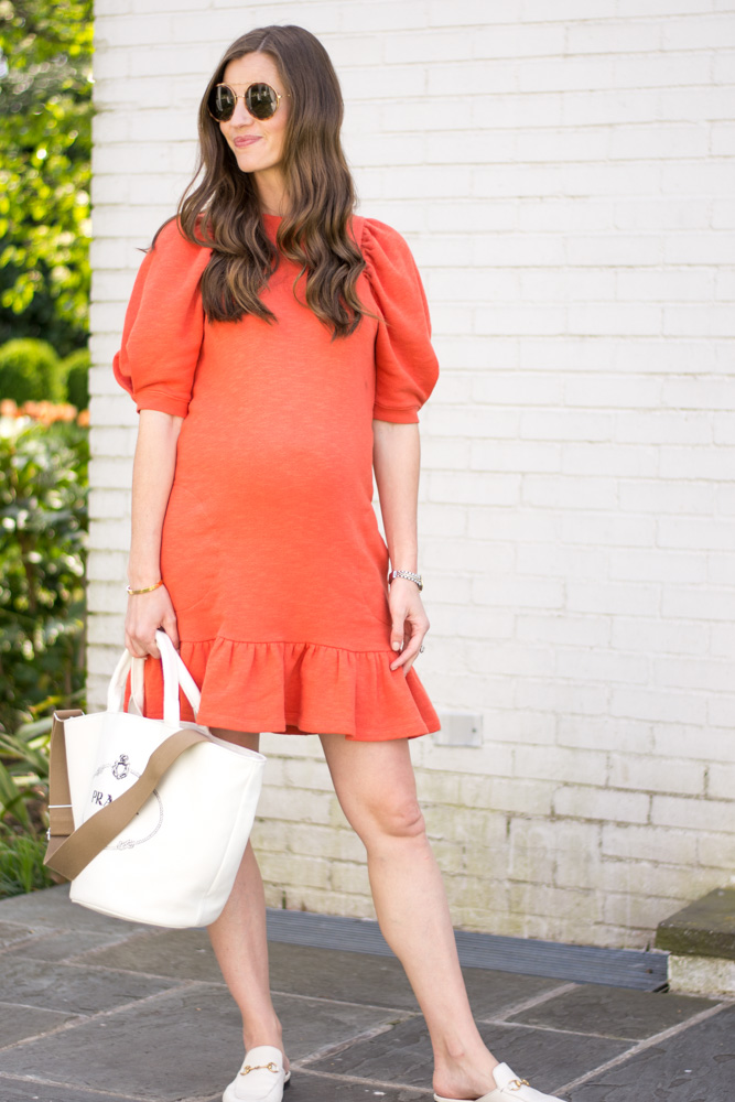 red ruffle hem sweatshirt dress white tote bag