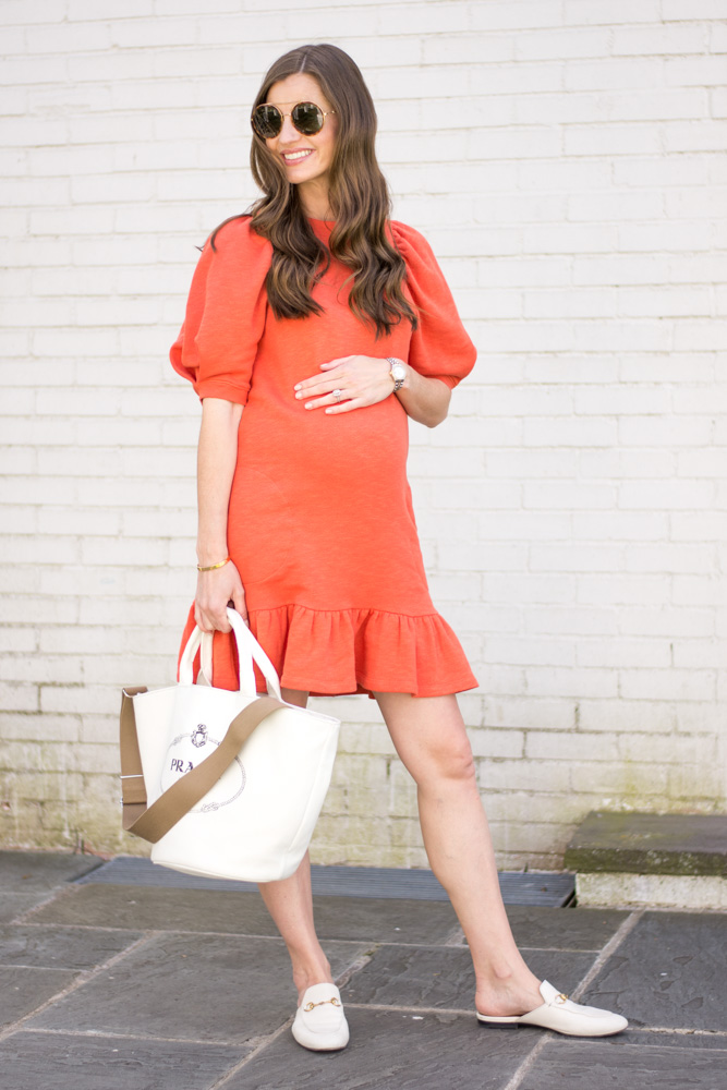 red ruffle hem sweatshirt dress white prada tote bag white gucci slides