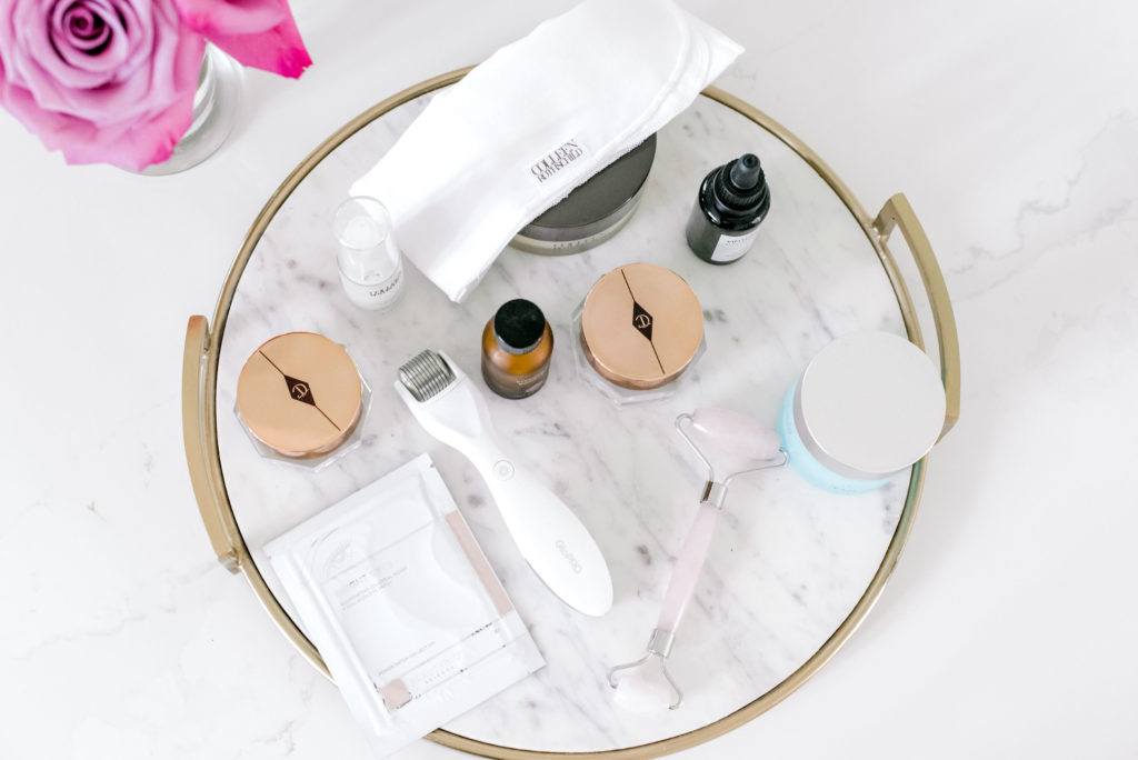 ten beauty products on a marble tray