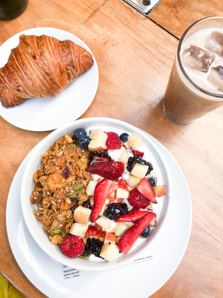 breakfast granola fruit croissant iced coffee