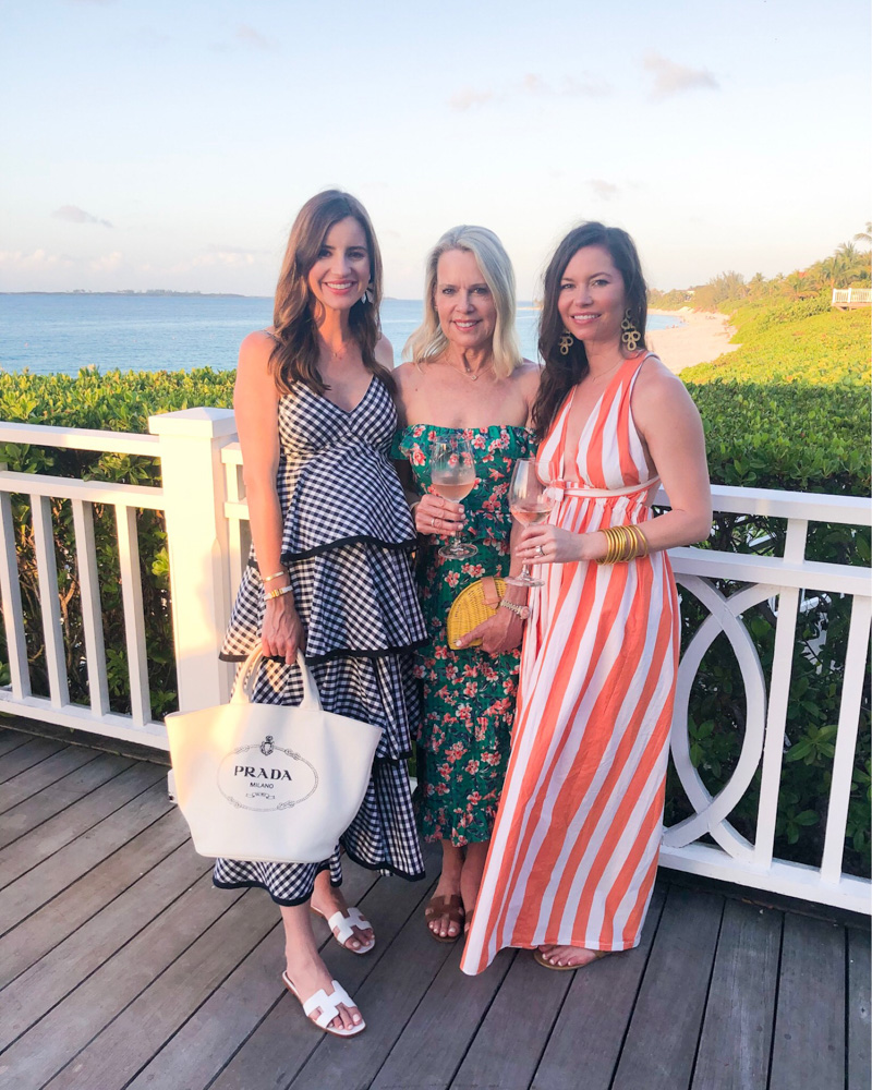 three women wearing maxi dresses overlooking beach