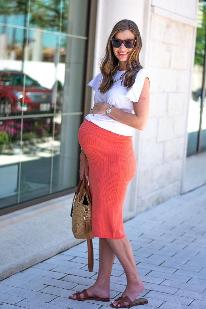 pregnant woman coral midi skirt