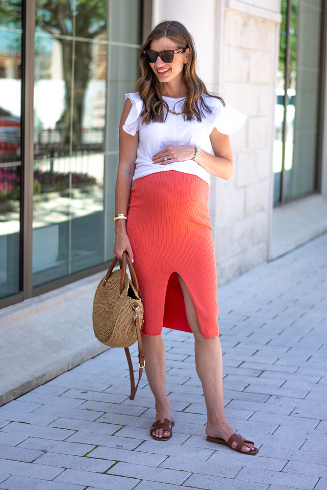 pregnant woman white tee coral skirt