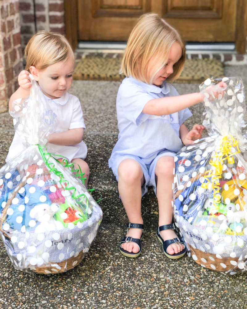 toddler boys opening Easter baskets