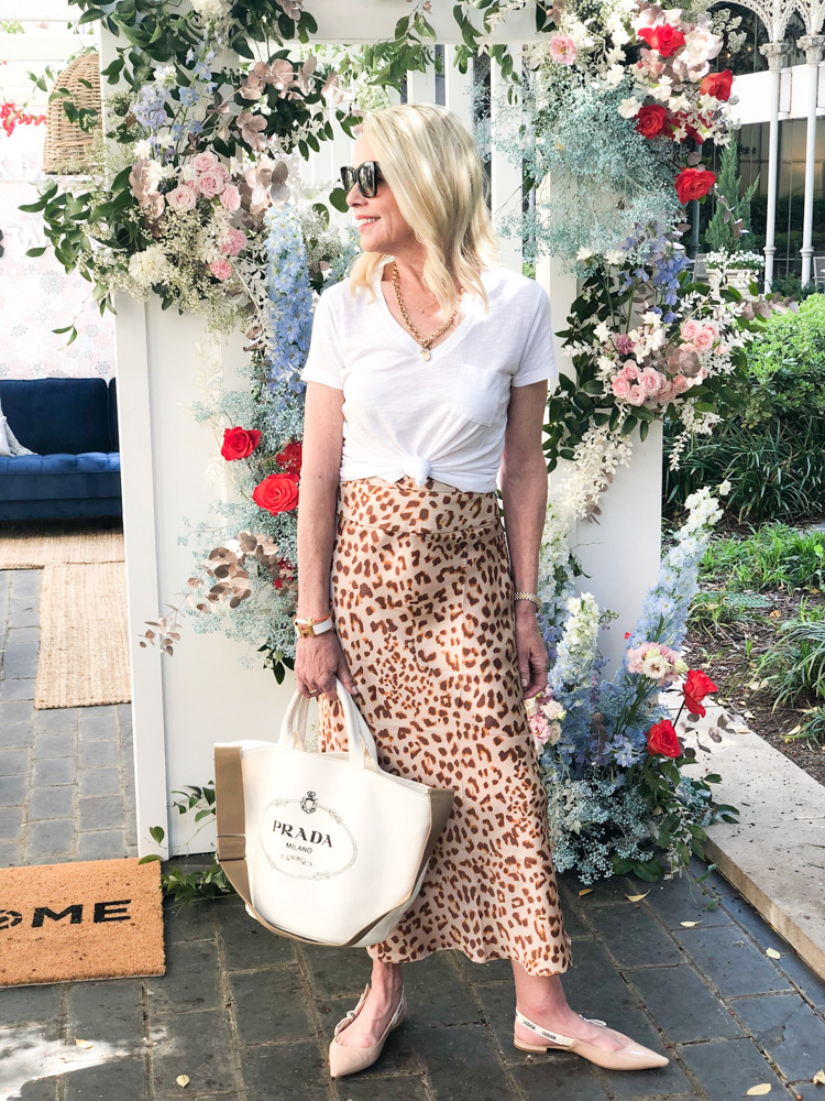 woman wearing leopard print skirt white tee