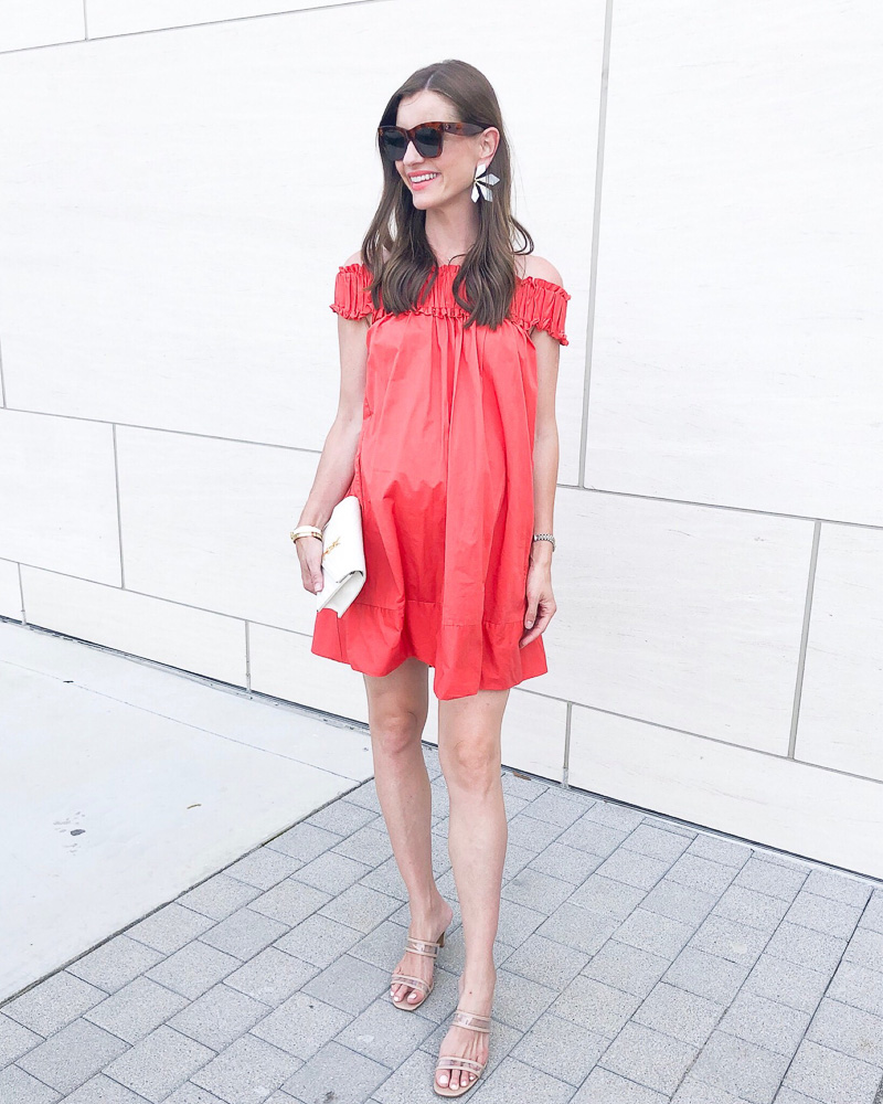 woman wearing coral maternity mini dress