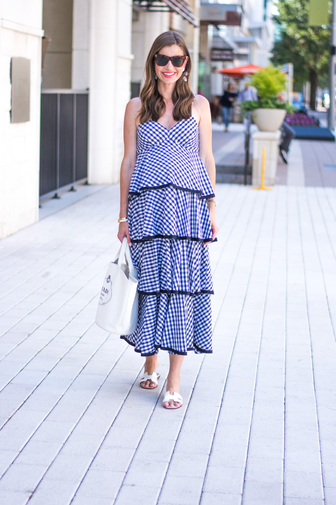 woman walking on street wearing tiered maxi dress