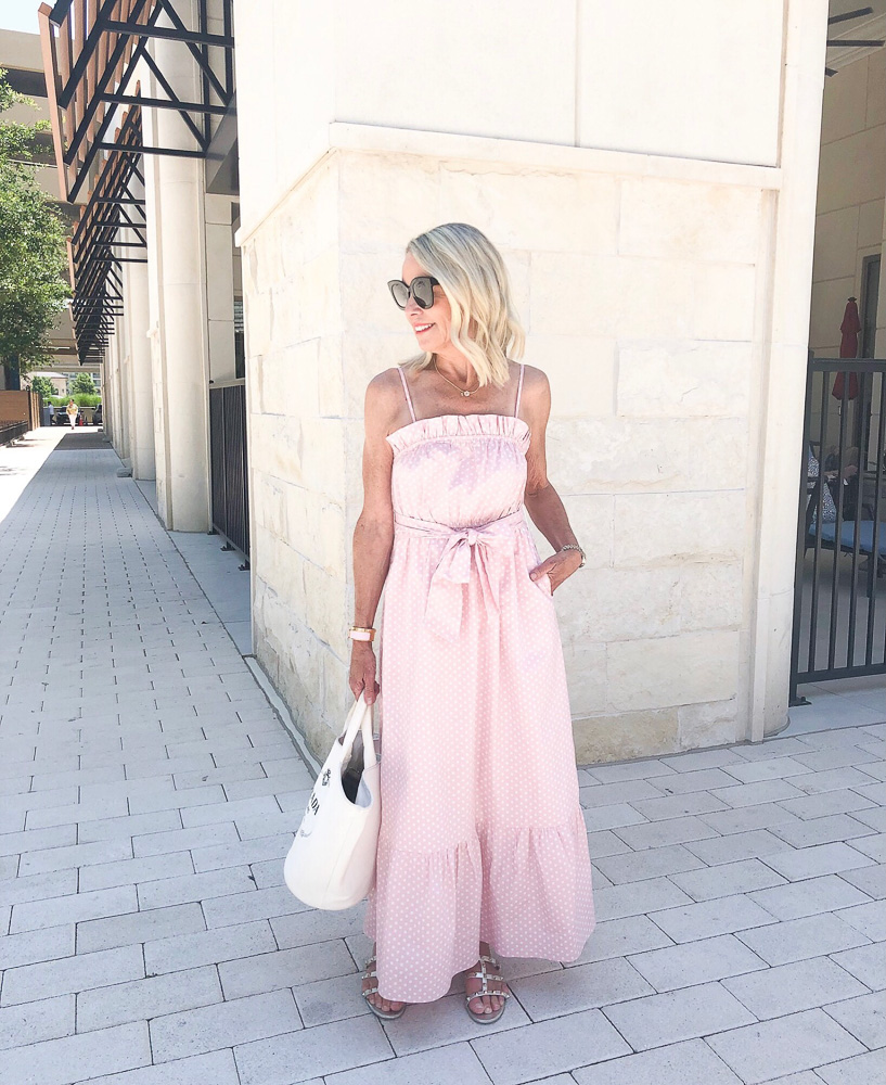 woman wearing pink white polka dot maxi dress