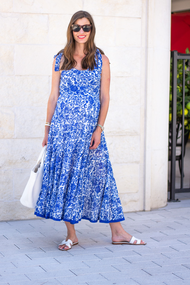 blue floral maxi dress worn by expectant mother