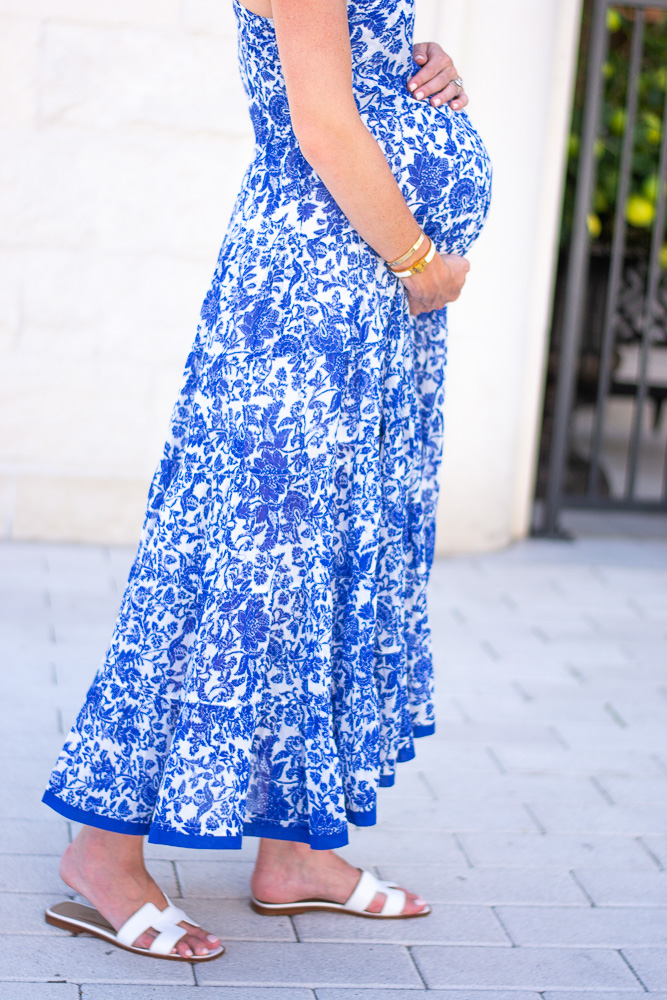 A non-maternity maxi dress that can be worn by a pregnant woman