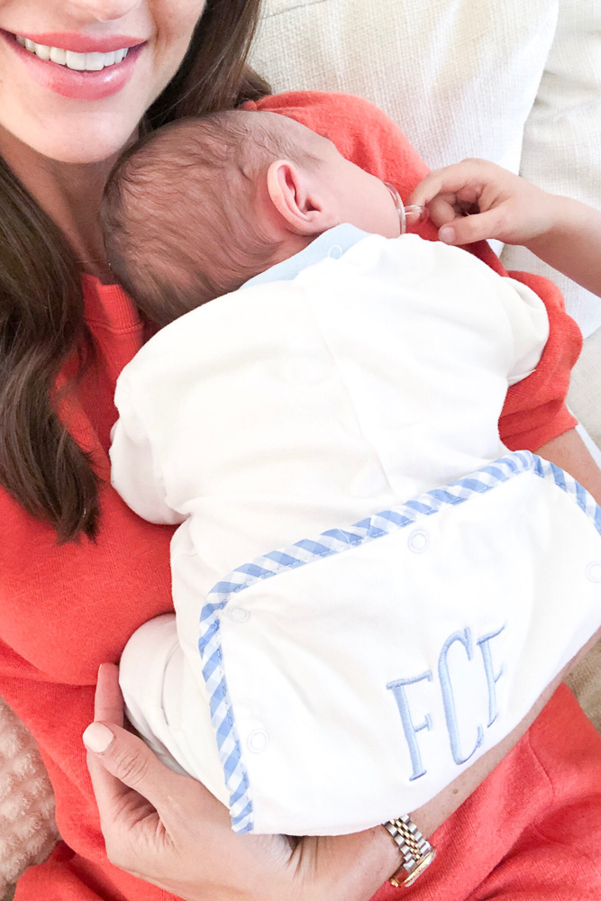 baby on monogrammed sleeper