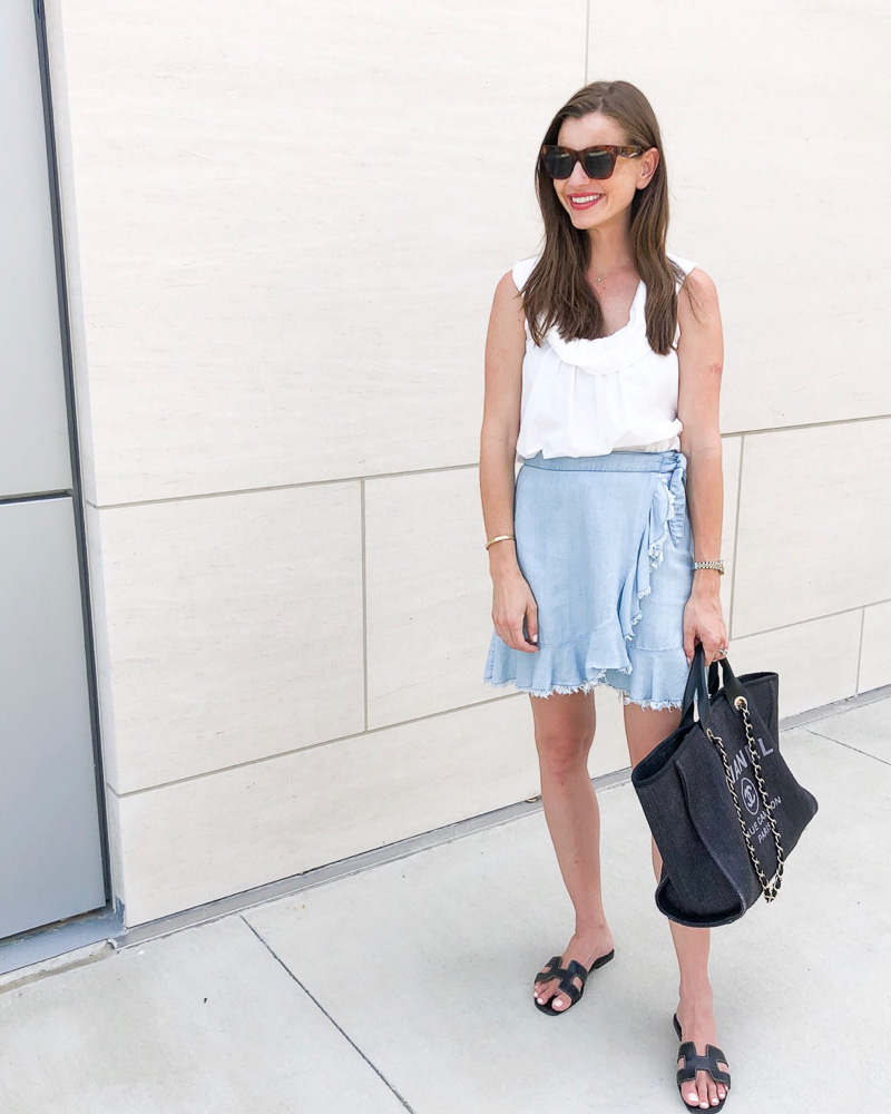 woman wearing white top denim skirt