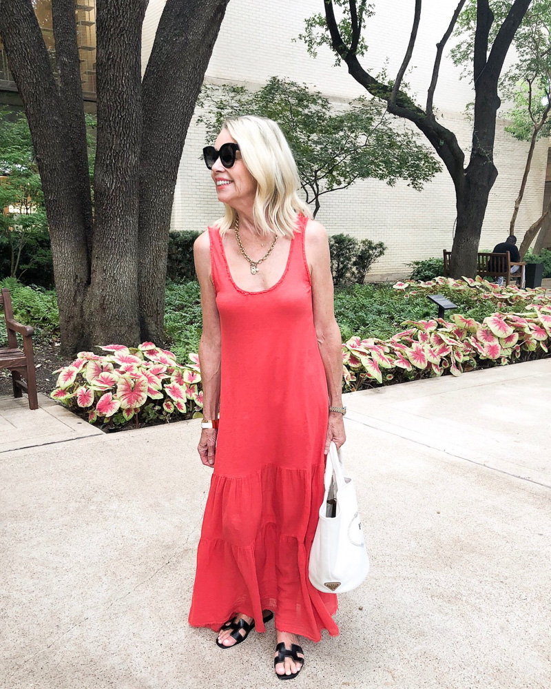 woman in red maxi dress