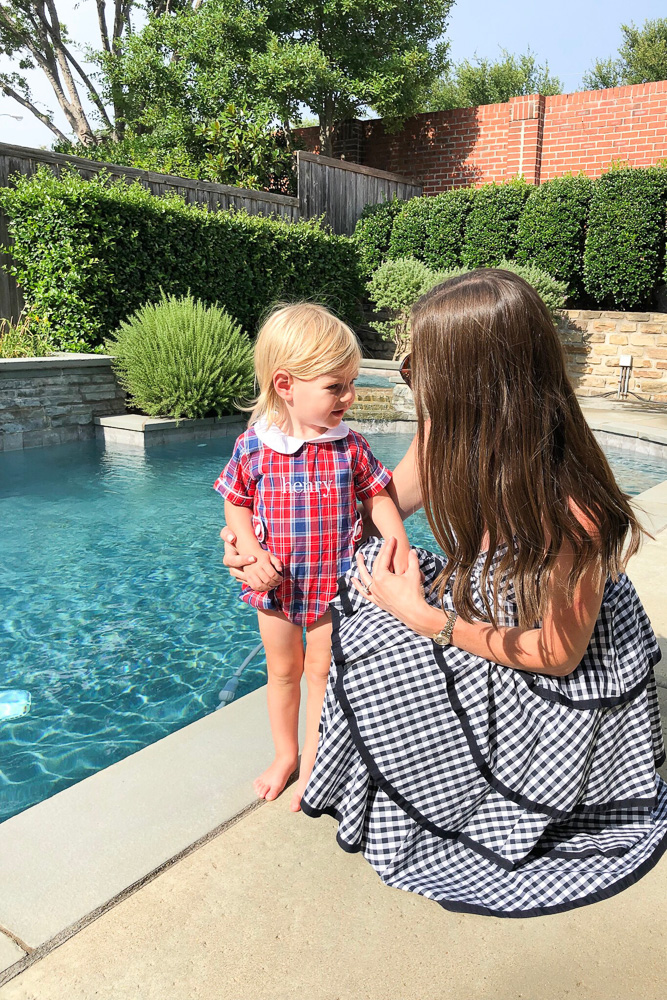 mother with toddler boy by pool