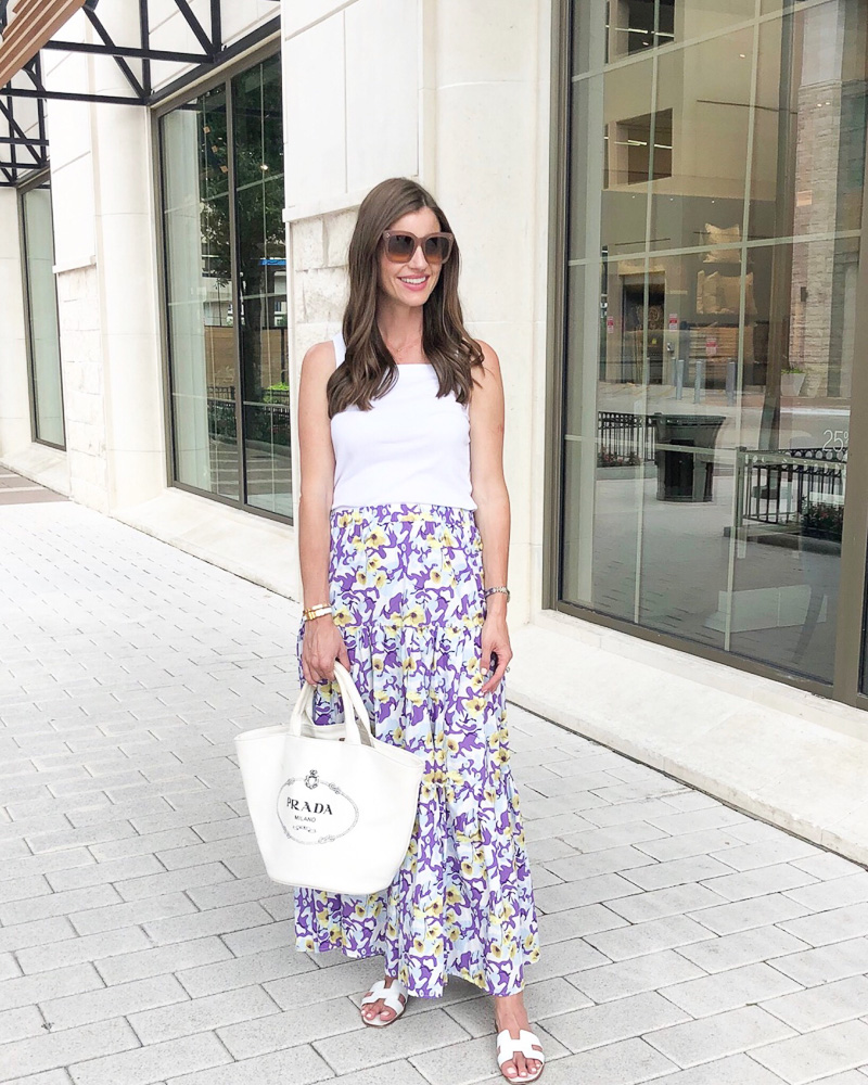 woman in floral maxi skirt and white tank top