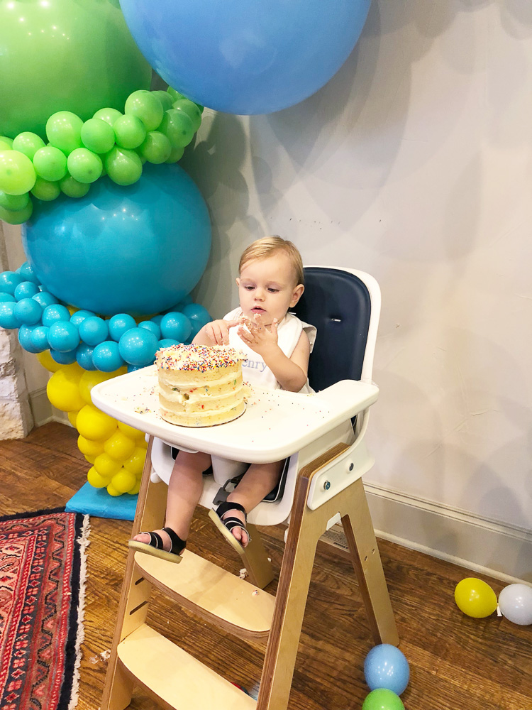 baby boy's first birthday eating cake