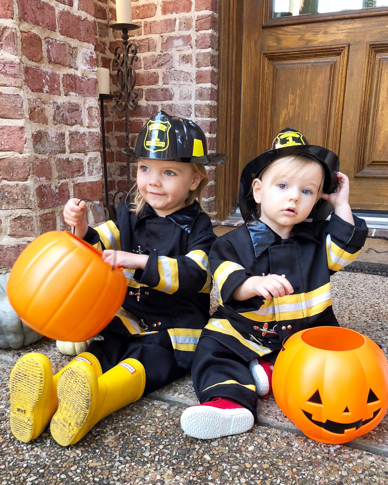 toddler boys in firefighter costumes
