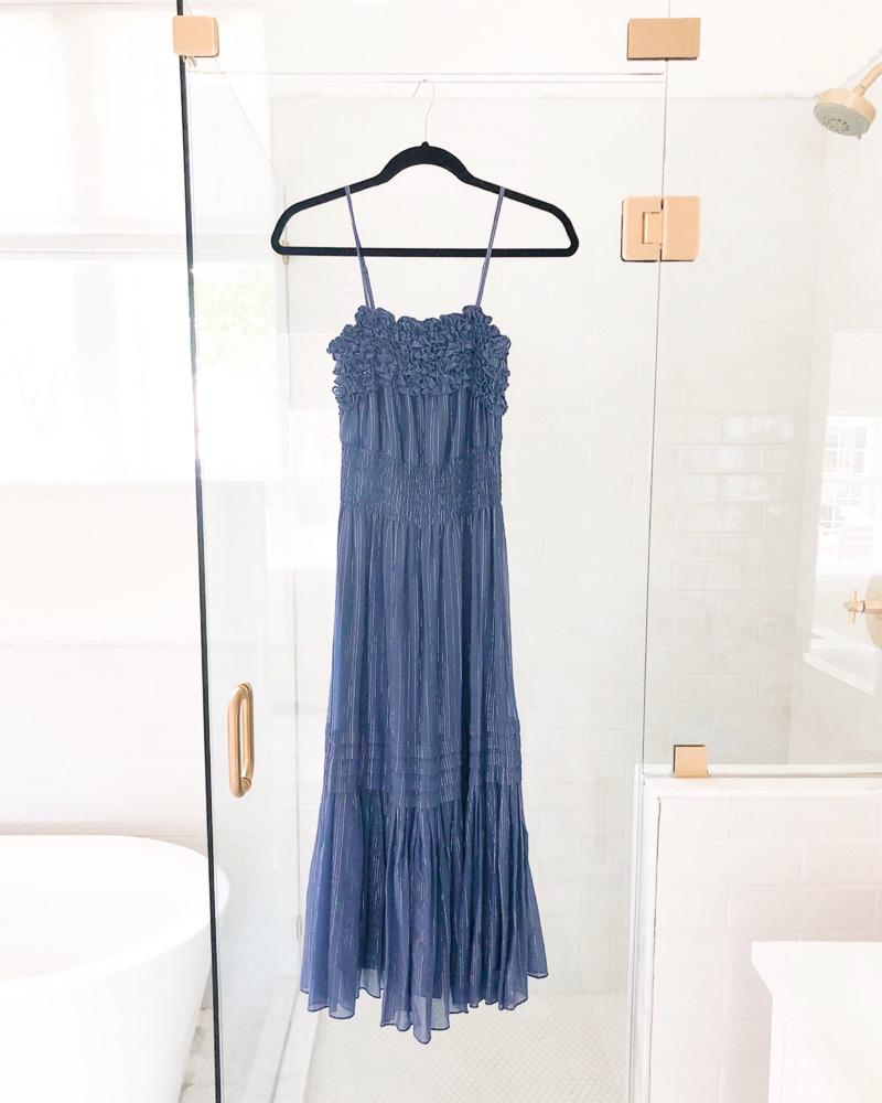 blue maxi dress hanging on shower door