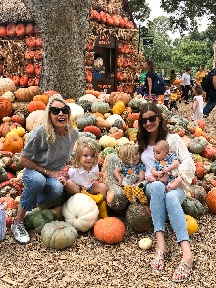 two women with children at pumpkin patch