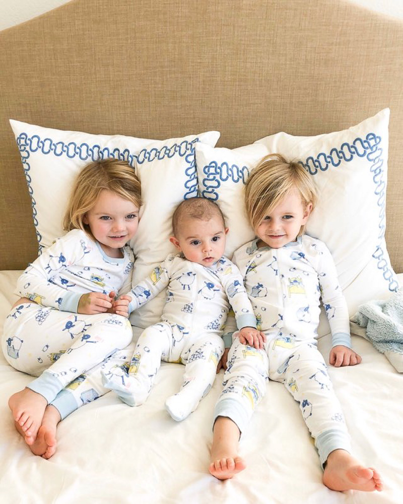 three brothers cuddling in bed