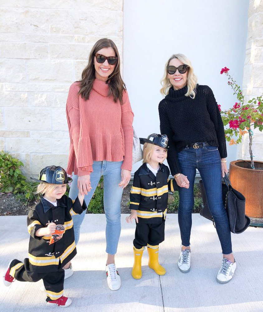 two women with toddlers dressed as fire fighters
