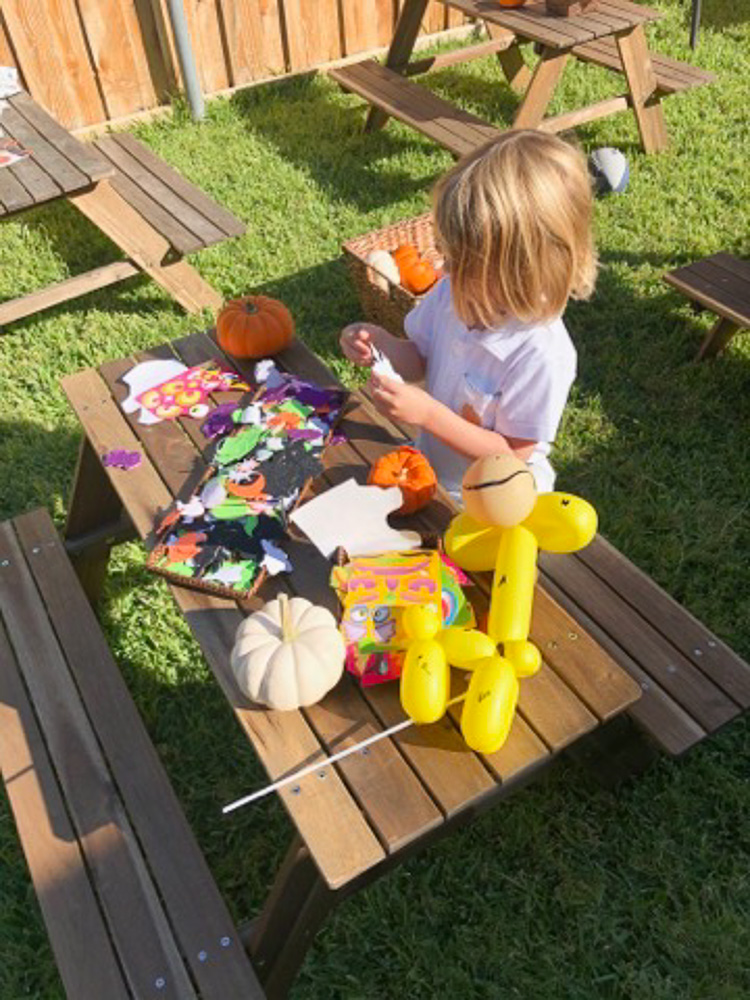 decorating pumpkin on picnic table