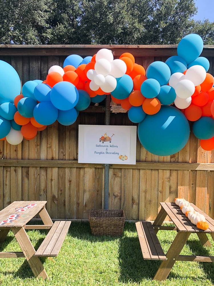 balloons and picnic tables for pumpkin party