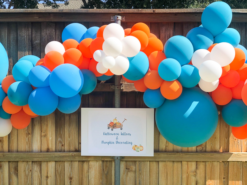 balloons and sign for pumpkin party