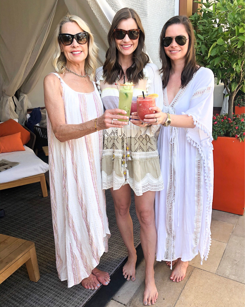 there women toasting at poolside cabana