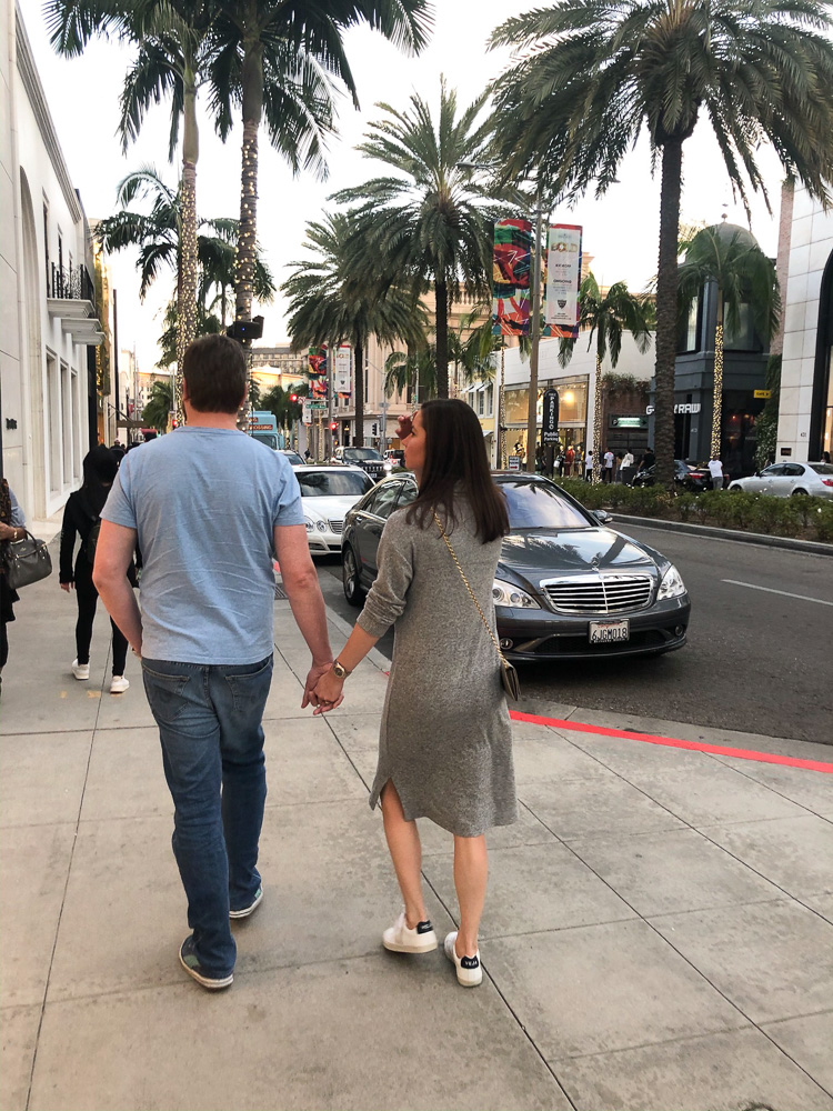 couple walking on rodeo drive beverly hills