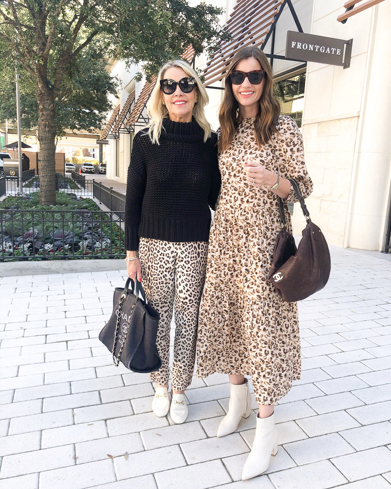 two women dressed in leopard print