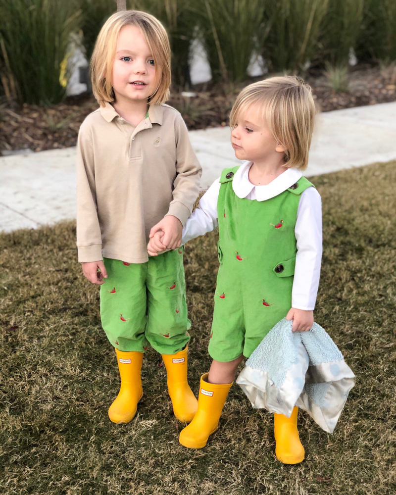 toddler boys in green with yellow boots