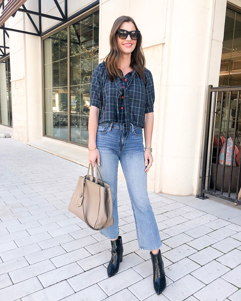 woman in plaid top crop jeans