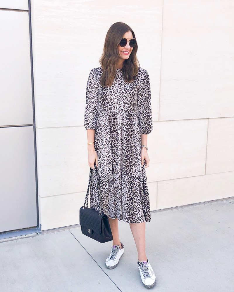 woman in leopard print midid dress and sneakers