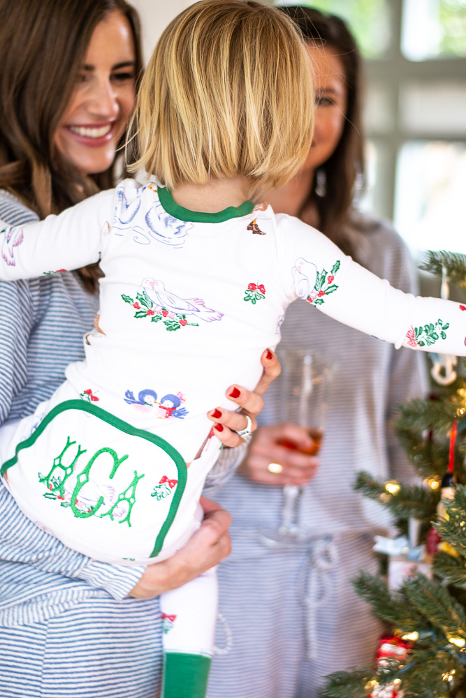toddler in monogrammed christmas pjamas