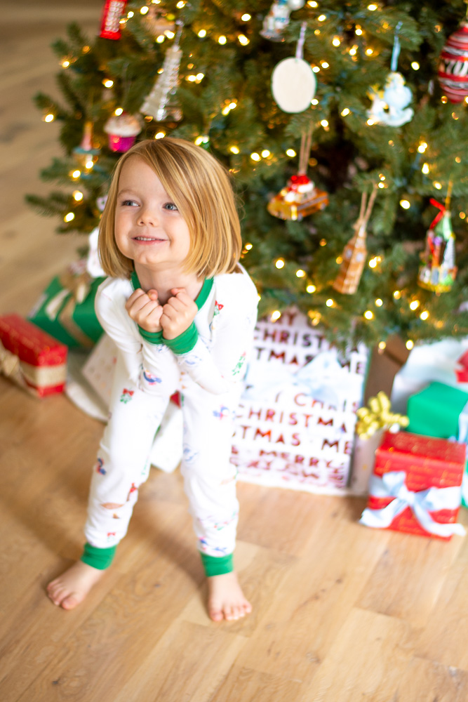 toddler boy in christmas pajamas