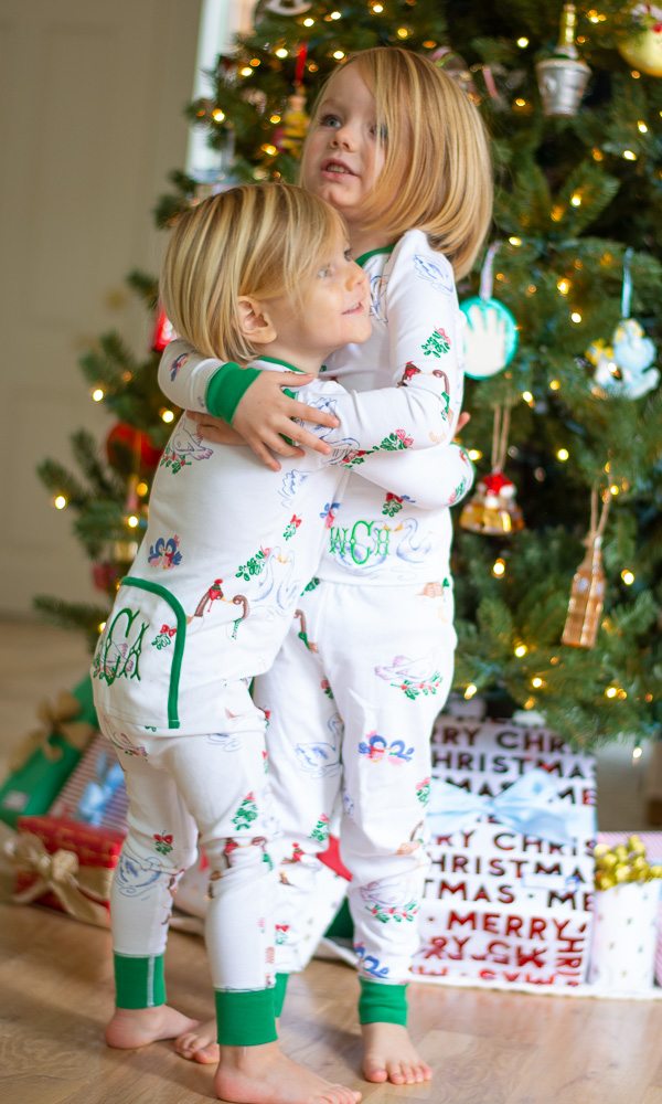toddler boys hugging in matching pajamas