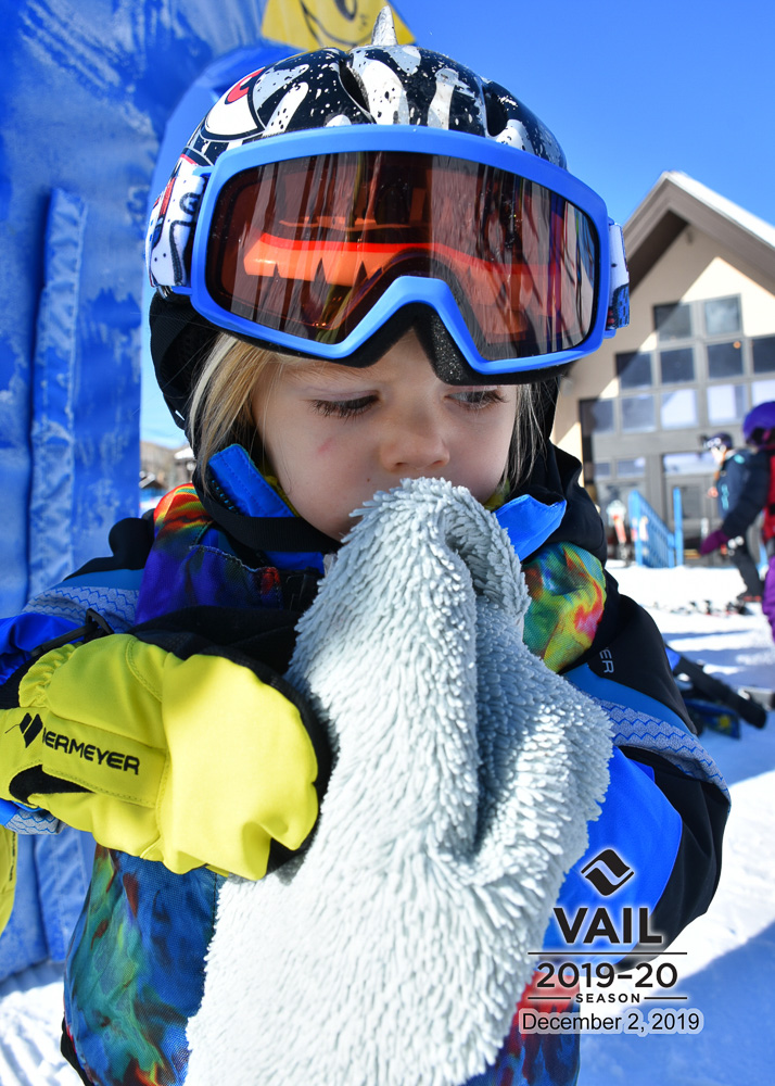 toddler in ski attire with blanky