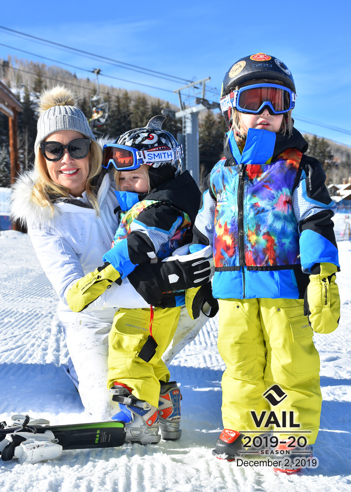 woman with two toddler boys at vail ski school