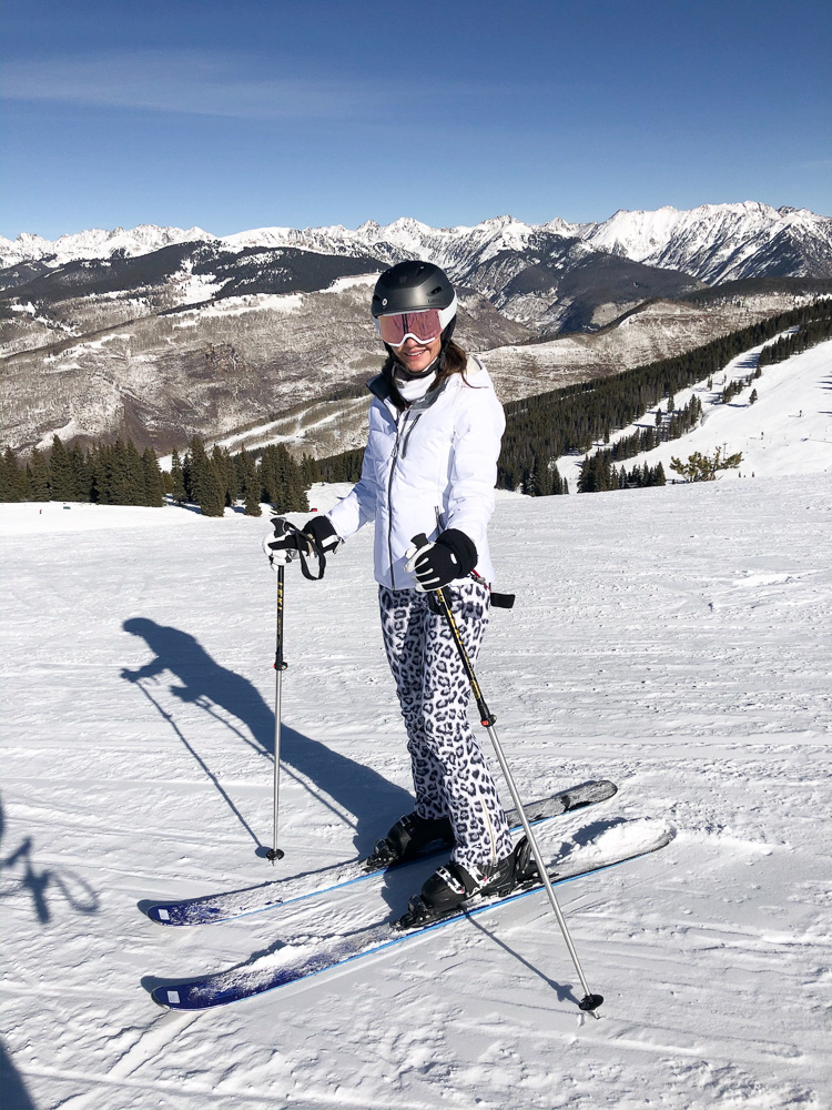woman skiing on top of vail mountain