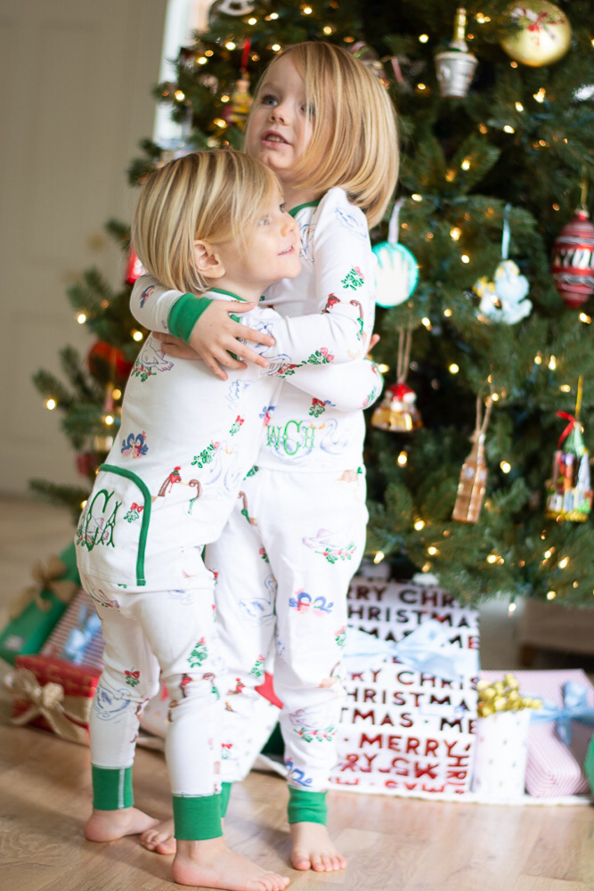 toddler boys hugging in christmas pajamas