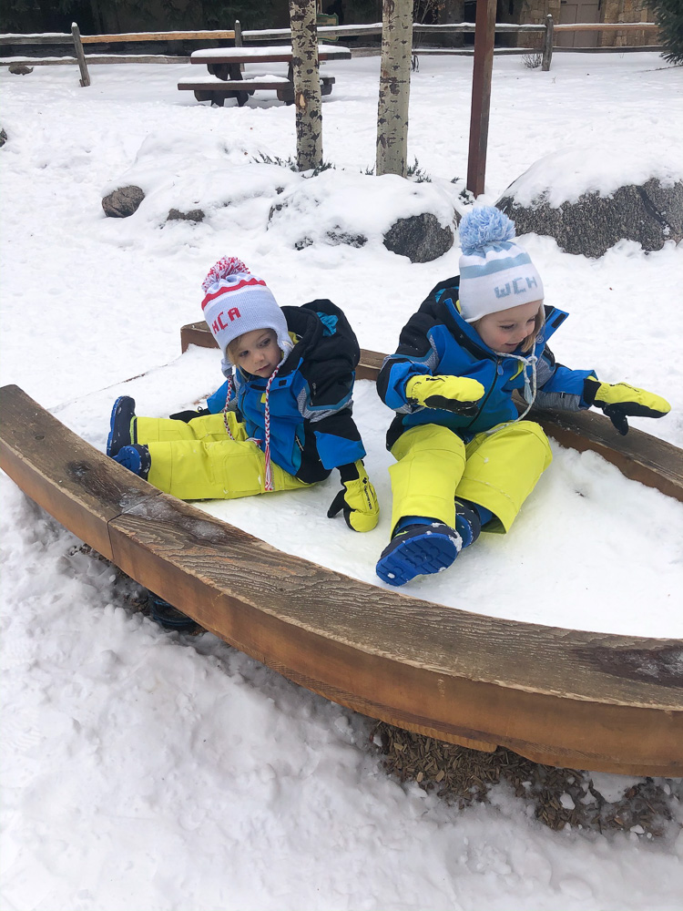 toddler boys playing in the snow