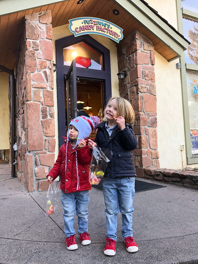 toddler boys outside of candy shop vail