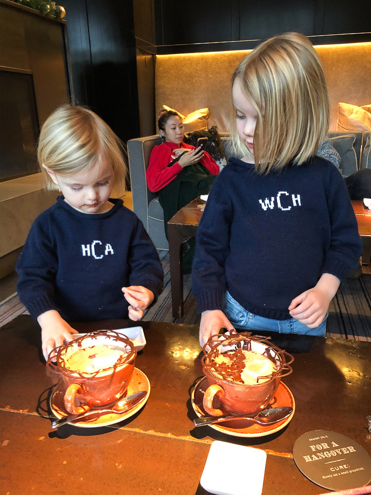 toddler boys enjoying hot chocolate at four seasons vail