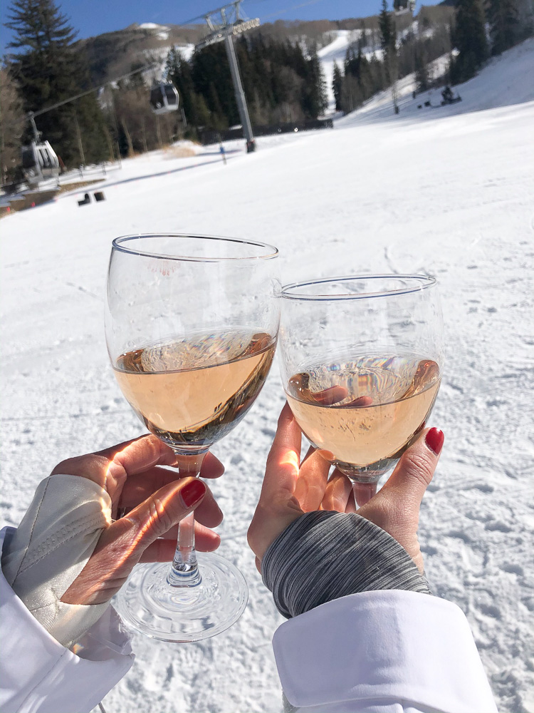 toasting with rosé wine in the snow