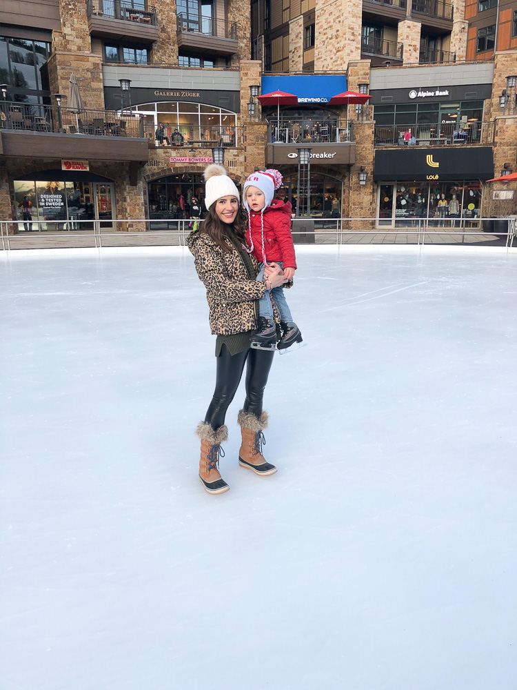 mom and toddler at ice rink