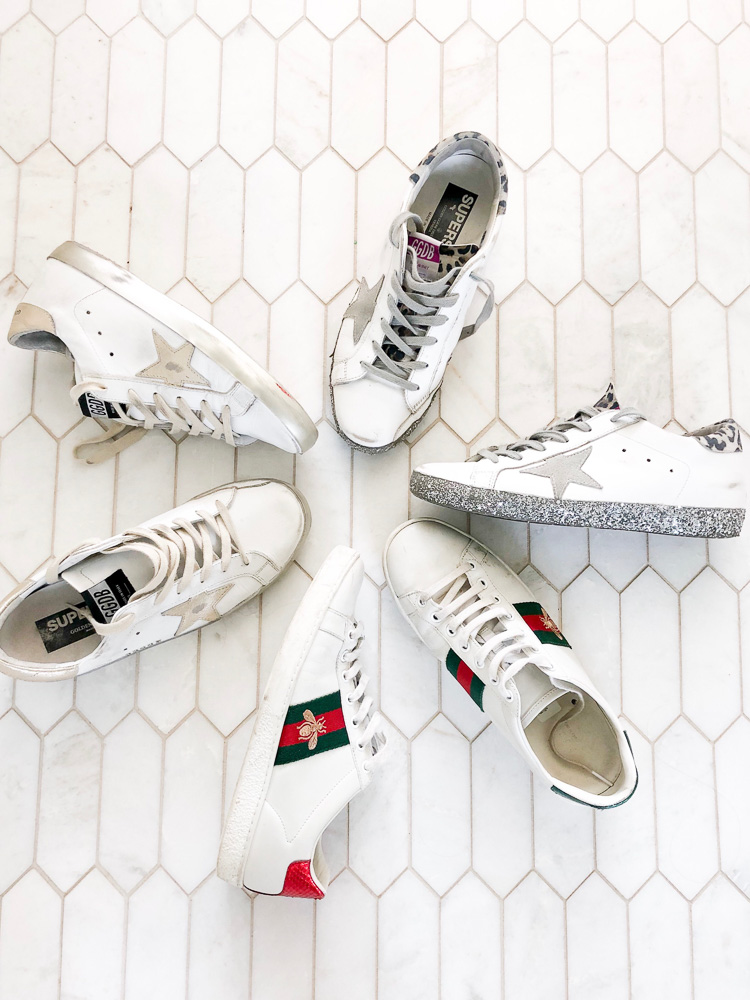 selection of gucci and golden goose sneakers