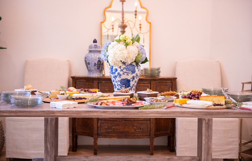 ding table with charcuterie and large floral arrangement