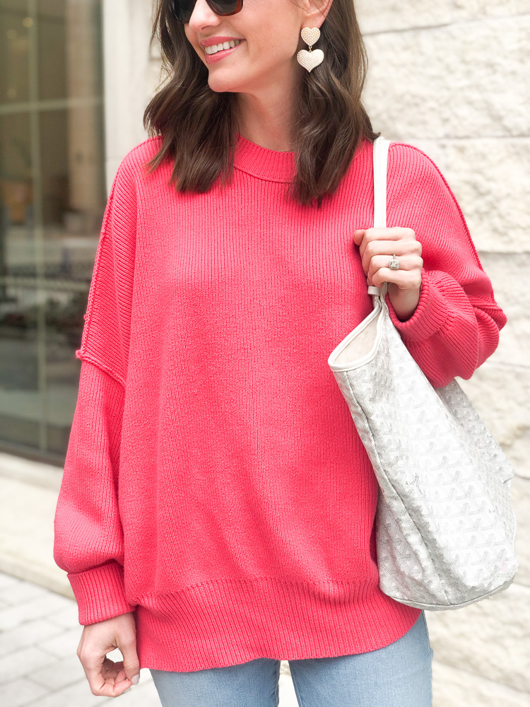 pink oversized sweater white heart earrings white tote