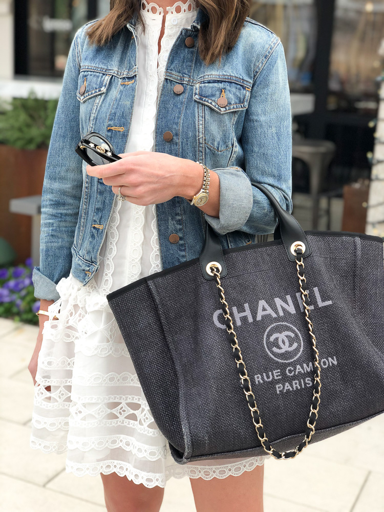 white lace dress denim jacket chanel tote bag